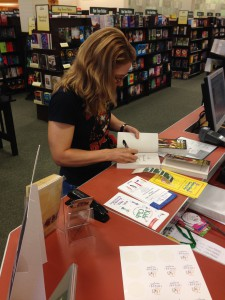 [9/16: Me signing my first books in public at the Goodyear, Arizona, Barnes & Noble]